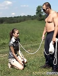 Kinky coach walks naked gymnast on leash
