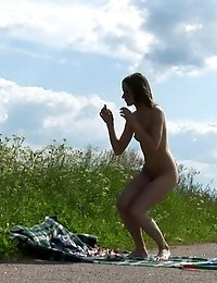 Slim miss does naked outdoor gymnastics