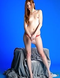 Adorable Redheaded Teen Girl With A Flawless Milk White Skin Shows Off Her Petite Nude Body.