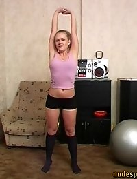 Smiley naked hotsy exercises with a Swiss ball